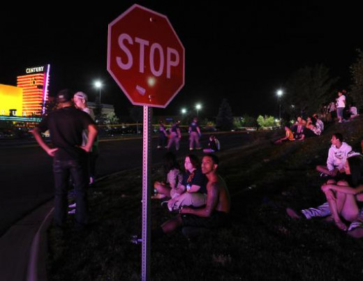 Moviegoers were evacuated across the street as Aurora Police strung crime scene tape around the parking lots encircling the movie theatre, July 20, 2012.