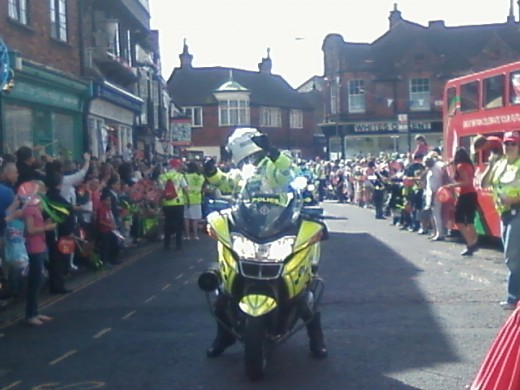 A dancing policeman at the torch relay in Sandwich