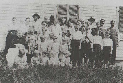 The family that Hattie and John Henry raised with help from Alice's mother, Sallie (front left seated)