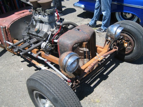 Junk yard parts and ingenuity are the staples of rat rods. If you look close, you can see the suspension on this vehicle is composed of an inverted leaf spring bolted to the chassis by a square plate—hardly high tech!