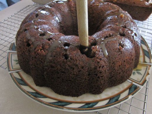Poke holes in the cake with a stick (or the bottom of a spoon).