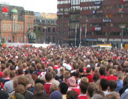 Atheists and believers have different interpretations of the Bible. Crowd of soccer fans in Copenhagen.