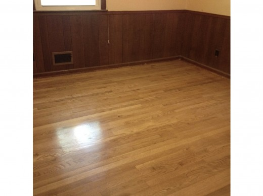 We didn't stain our hardwood floors, but they look terrific. (I'll have to get rid of that horrible paneling soon, too!)
