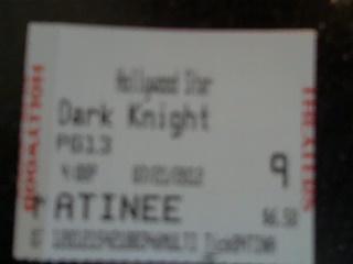 "Movie ticket stub from ""The Dark Knight Rises""."