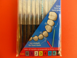 Dental brushes are sized by color-code.