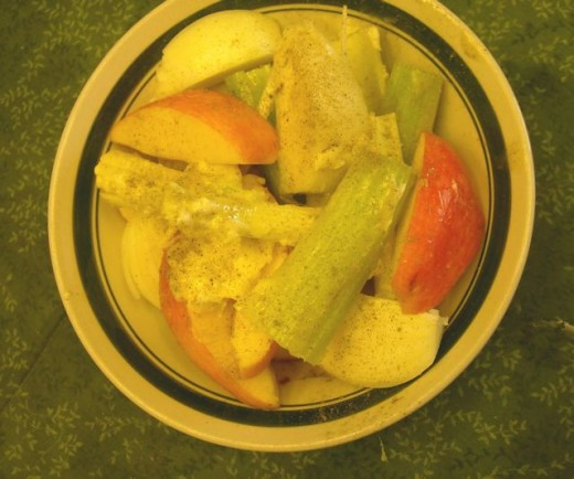 Apples, celery and onions  coated with softened butter and poultry seasoning.