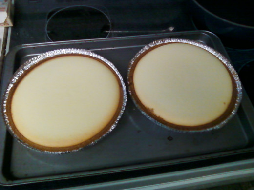The two cheesecakes using the store bought pie shells right out of the oven (right at 40 minutes bake time).