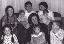 clockwise from left: pregnancy #3, pregancy #13, Dad, babysitter, Mom, pregnancy #13, pregnancy # 6, pregnancy #10, and pregnancy #4 in 1963.