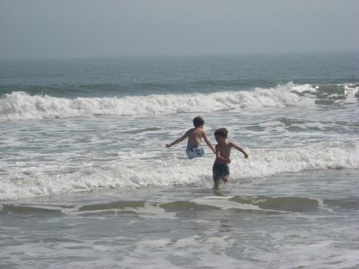 Jonathan and Tristan navigate the waves.