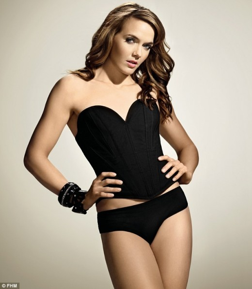 Glamorous: Miss Pendleton poses in a black basque in the run-up to the London 2012 Olympics