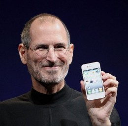 The late Steve Jobs showing the world one of his creations, the iPhone 4.
