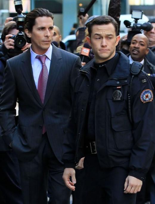 Christian Bale as Bruce Wayne and Joseph Gordon Levitt as Blake