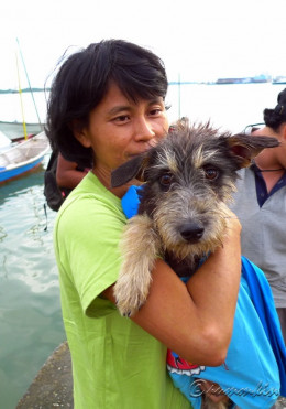Sabrina during one moment with a new dog she rescued from Pulau Ketam