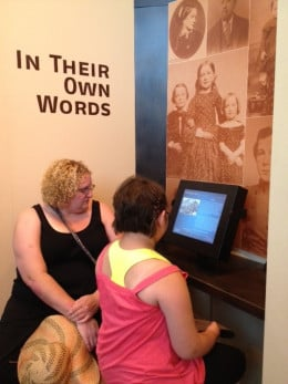 My sister and daughter doing an interactive display that provided 3 different points of view for several different events that have happened over time