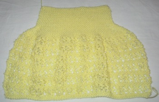 Knit two panels: front and back.