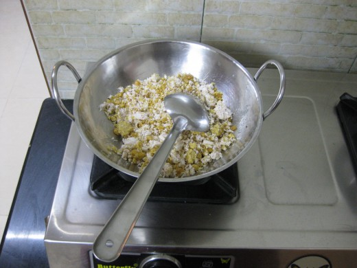 Add the grated coconut and jaggery in a wok and cook them on medium flame for 10 minutes