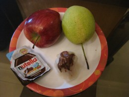 Dumpling stuffed with fruit pieces and drizzled with Nutella
