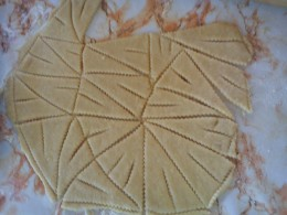 Using the zig zag (or pizza) wheel, triangular shapes are cut.  All edges should be zig zagged, even on the outer edges.  No cookie dough is wasted.