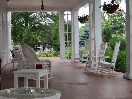 Relax on the spacious front porch of the Eastern Slope Inn Resort!