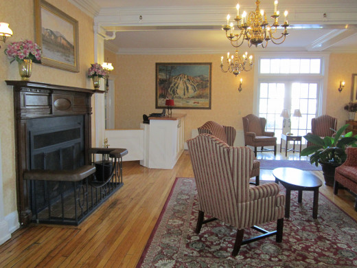A Huge Fireplace and Cozy Sitting area is waiting for you in the Lobby of the Eastern Slope Inn Resort.