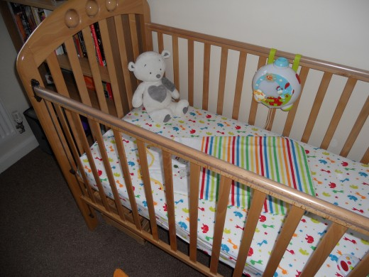 Our second hand cot. Kitted out with mattress, light projector, sleep bag and first teddy. The mattress for your cot MUST fit snugly, with no more than a 3mm gap around the edge.