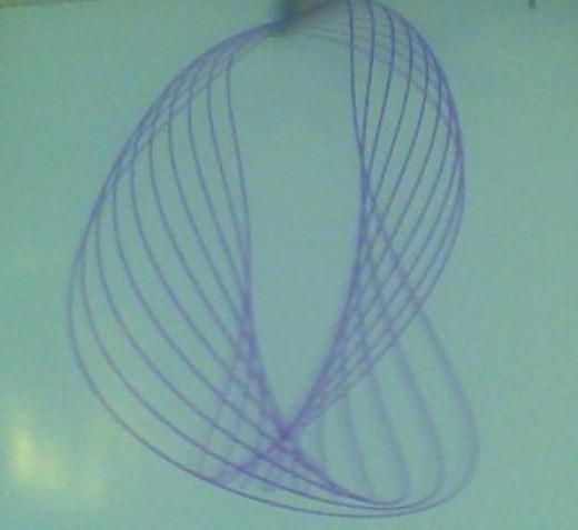 Kinesthetic pendulum design created with a purple marker at a local science museum