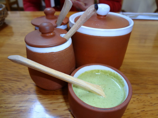 Ocopa: Peruvian-style sauce made of local herbs, fresh cheese and peanuts.