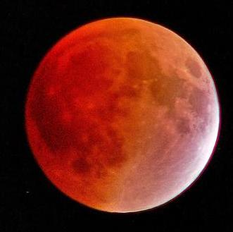 Red and copper coloring of a total lunar eclipse.