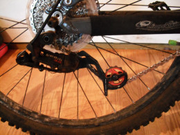Derailleur with a proper length chain