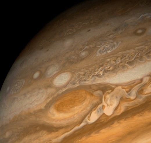 A close up on the Great Red Spot. This massive storm is larger than the Earth and has been raging for 400 years. It is unclear what makes it red.
