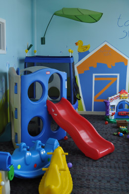 The infant/toddler play room is a great place for young ones. Couches are outside the safety gate, as well as children's tables for eating lunch and snacking.