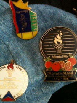 This writer wore the spoils of 1996 Olympic pin trading on her Olympic hat.