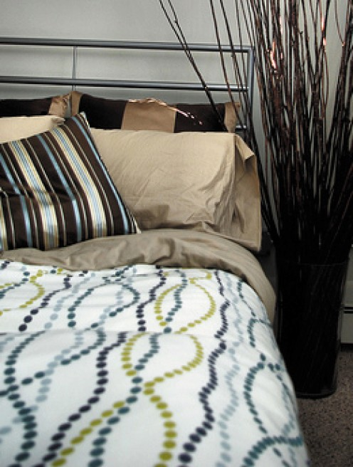 Create a unique bedding look by mixing and matching complimentary patterns and colors.