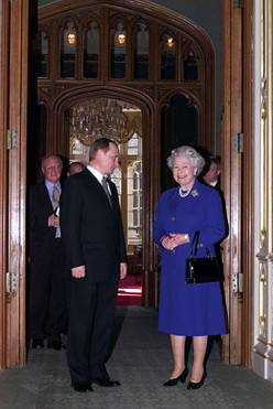 What does Queen Elizabeth carry in that pocketbook?