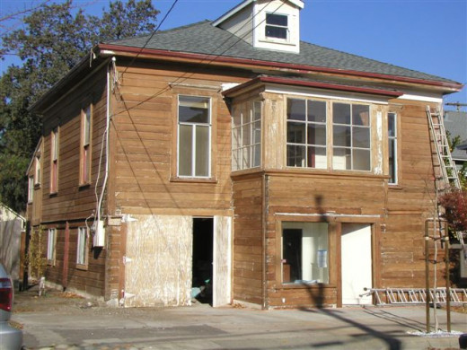 Stripped down to bare, beautiful redwood.  The entire home is constructed of Redwood; which is pretty impervious to dry rot and termite infestation/damage.  The exterior wood as well as framework and interior solid 1x6 wall construction is redwood