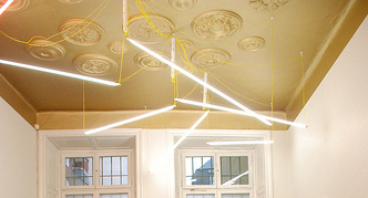 This ceiling features gold paint and extends the color down onto the wall to give it a much higher appearance.
