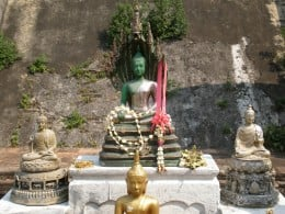 Buddha sculptures at an improvised altar in Wat Chedi Luang. Chang Mai, Thailand.