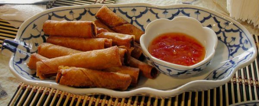 tasty lumpiyang shanghai with some chili sauce to add to the great taste! nicely served with rice
