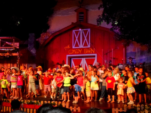 All the kids in the audience including my son dancing on stage.