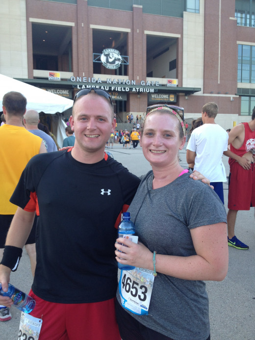 My brother Corey and I after the race...getting to finish my first race with a lap around Lambeau was priceless!