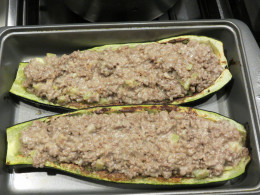 Spoon meat mixture into zucchini halves.