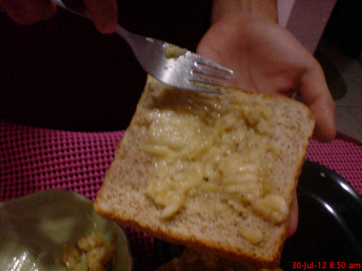 Spread the mashed banana onto the slice of wheat bread