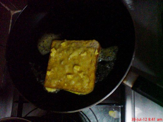 Place in a pan on low heat with half spoon of butter for each bread, toasting it slow on both sides