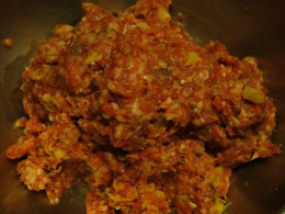 This is a picture of the mixture of ground beef, spices, bacon, and pineapple after being hand squeezed and mixed together before forming the patties.