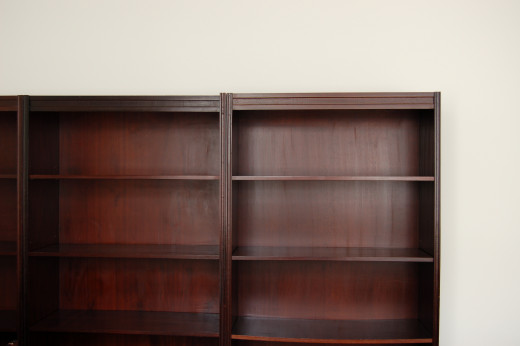 Remove your old bookcase's shelves and you can turn it into a freestanding closet.