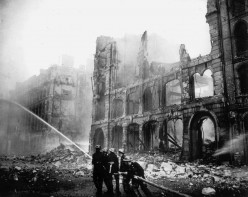 A British firefighting team trying to control a fire in London during the Battle of Britain, September 1940.