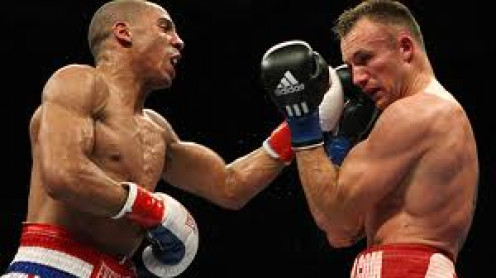 Andre Ward attacks Mikkel Kessler on his way to winning the super middleweight championship.