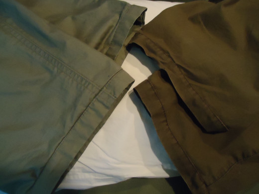 Two pair of hemmed pants