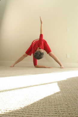 Windmill, or standing twist in wide-legged forward fold, squeezes and twists the organs.