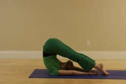 Plough, or Halasana, relaxes the back, stretches the backs of the legs, and strengthens the abdominal muscles.